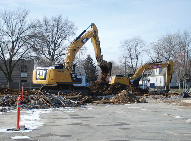 Demolition at the intersection of Eighth and Carpenter.