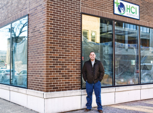 Chris Stone stands outside the future site of his marijuana dispensary at 628 E. Adams St.